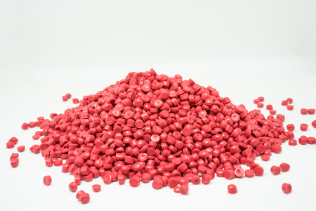 Red Plastic pellets. Colorant for plastics.