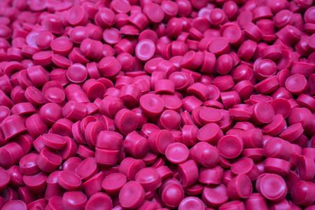 Pink Plastic pellets. Colorant for plastics. Banco de Imagens