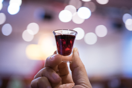 A believer is involved in a Holy Communion.