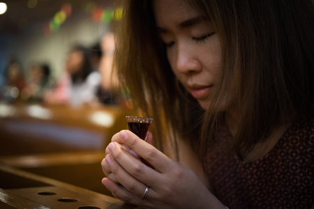 A believer is praying and she is involved in a Holy Communion.