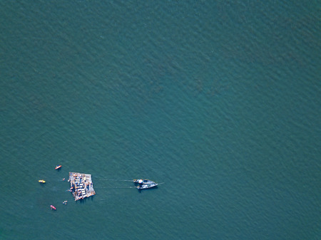 Top View of raft and boats in the sea.