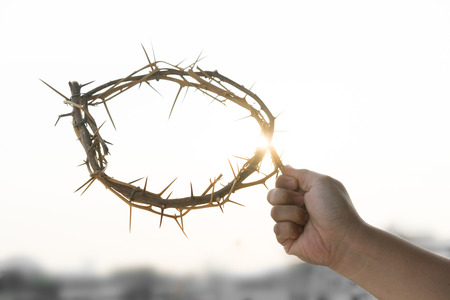 A crown of thorns in the hand of a man on good friday.