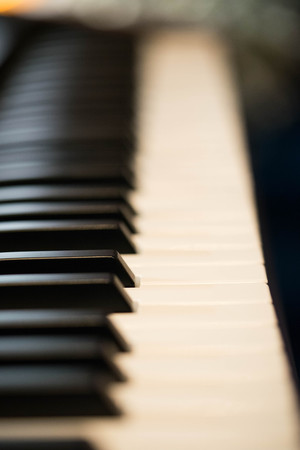 Close up the keyboard of a vintage piano.
