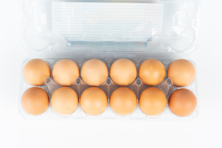 the pack of eggs in plastic packaging with white background.