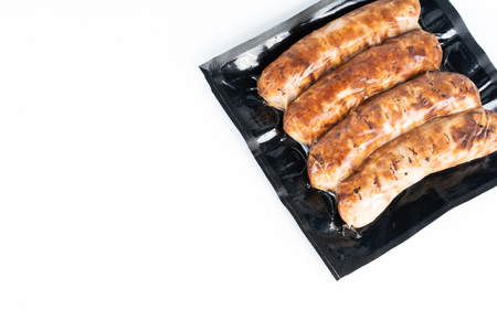 The grill sausages in plastic pack in white background. Banque d'images