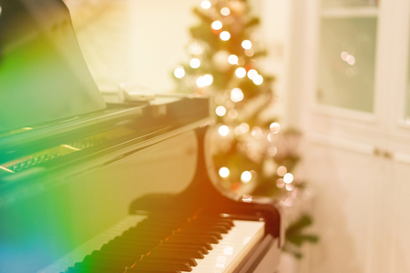 A piano in the warming room in the Christmas night.
