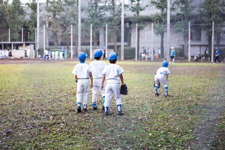 Baseball kid team is practicing hard in the field to prepare for next season's game.