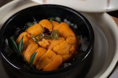 Uni Don on the table in the Japanese restaurant.
