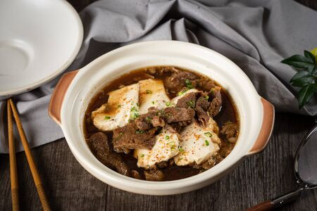 Niku Tohfu, Spicy beef and tofu Japanese suki in the traditional Japanese restaurant 写真素材