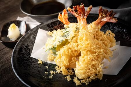 The tempura shrimps with sauce, deep-fried shrimps in the traditional Japanese restaurant.