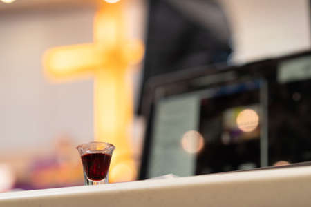 A Christian man is involved in holy communion by the online church at his house: Sunday service online, New normal life.