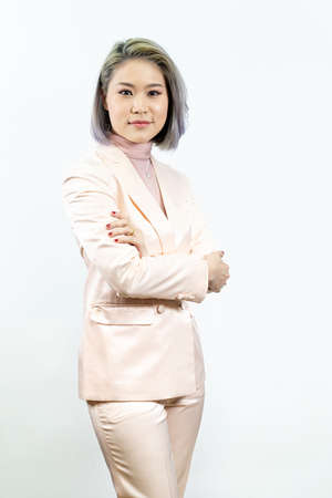a working woman is standing with confidence on the white background in the studio.
