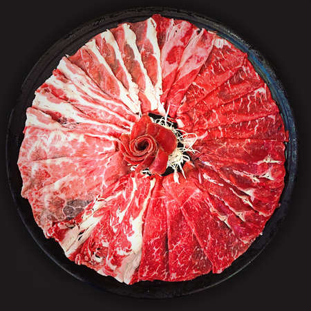 Many types of Beef raw sliced and put on the dish for Shabu in the Japanese restaurant.