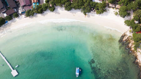 Sea aerial view, The color of the water and beautifully bright. The beach with rocky mountains and clear water of Thailand ocean on a sunny day. Landscape background.