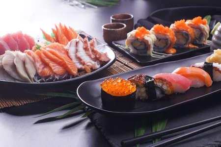 Sashimi and sushi Japanese food set. Salmon, Ikura, wasabi, fish, shrimp and tuna in a Japanese restaurant. Standard-Bild - 157107836
