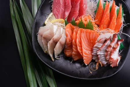 Sashimi Japanese food, Sashimi set. Salmon, wasabi, fish, shrimp in a Japanese restaurant. Standard-Bild - 157107519