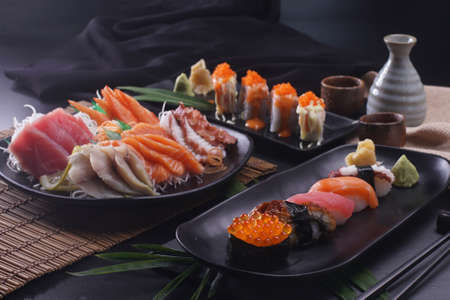 Sashimi and sushi Japanese food set. Salmon, Ikura, wasabi, fish, shrimp and tuna in a Japanese restaurant.