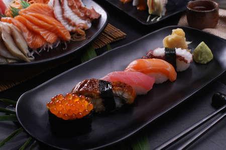 japanese sushi food set. Maki ands rolls with tuna, salmon, and shrimp. Rainbow sushi roll, uramaki, hosomaki and nigiri in a Japanese restaurant.