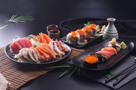 Sashimi and sushi Japanese food set. Salmon, Ikura, wasabi, fish, shrimp and tuna in a Japanese restaurant. Standard-Bild