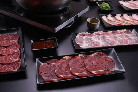 Shabu Shabu or Sukiyaki, a popular dish of pork, beef, shrimp, squid, seafood and fresh vegetables. Placed on a table with a boiling pot boiling in a Japanese restaurant.