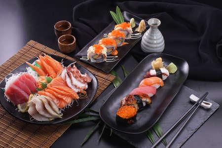 Sashimi and sushi Japanese food set. Salmon, Ikura, wasabi, fish, shrimp and tuna in a Japanese restaurant. Standard-Bild - 157107878