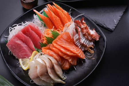 Sashimi Japanese food, Sashimi set. Salmon, wasabi, fish, shrimp in a Japanese restaurant. Standard-Bild - 157107961