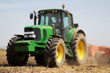 non cultivated: Rural scene with tractor plowing the land in autumn
