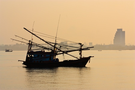 fishman: fishman boat silhouette at sunrise Stock Photo