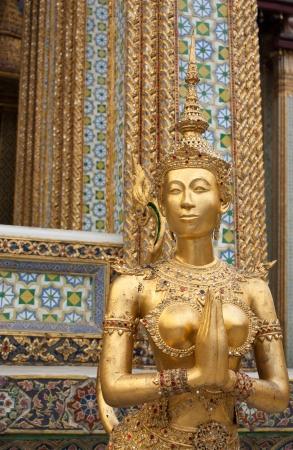 Golden kinnari at Wat Phra Kaew,Bangkok Thailand photo