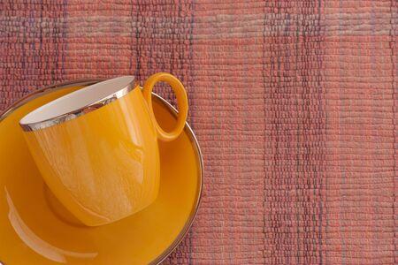 hand woven: tazza di caff� su tessuto intrecciato a mano Archivio Fotografico