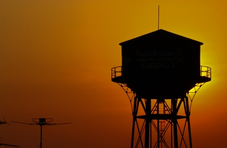 old water tank silhouette at sunset  photo