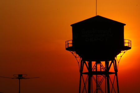 old water tank silhouette at sunset  Stock Photo - 18857106