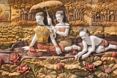 thai painting: Thai culture stone carving on temple wall Stock Photo