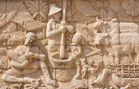 stone carvings: Thai culture stone carving on temple wall Stock Photo