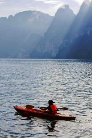 kayaking on the mountain lake  photo