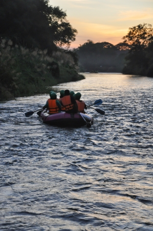 river rafting at sunset photo