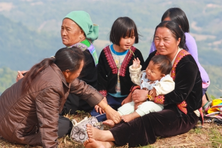 PHETCHABUN, THAILAND � NOV. 27 : Hmong family see views  on Phu Tub Berk on November 27, 2010 in Phetchabun, Thailand.