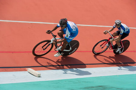 velodrome: BANGKOK, THAILAND - AUGUST 10   Unidentified athletes riding  bike at Queen s Cup Thailand Championships, on August 9-10, 2014 at Huamark Velodrome in Bangkok, Thailand
