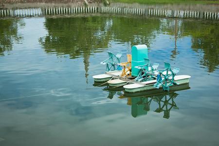 water turbine: Water turbine floating on the pond Stock Photo