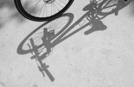Bicycle wheel and shadow on blackground