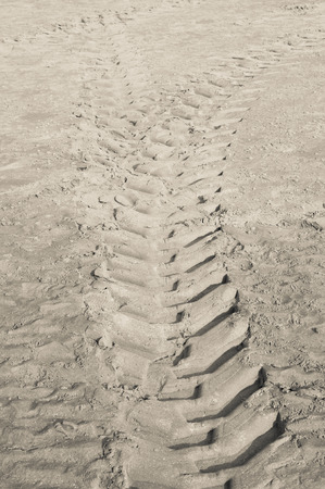 tire tracks: Tractor tire tracks on beach sand Stock Photo
