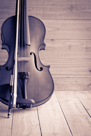 fiddles: Vintage of violin and fiddle on wood background Stock Photo