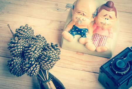 grandparents: Grandparents  ceramic dolls on wood background with retro style