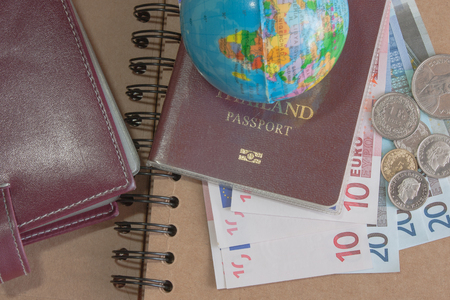 passbook: Money euro banknotes, coins,globe,passbook  and passport on book