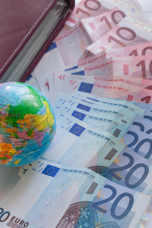 passbook: Money euro banknotes, globe  and passbook Stock Photo