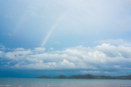 pristine corals: Colorful rainbow over tropical beach Stock Photo