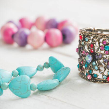 Bracelet on white wood background