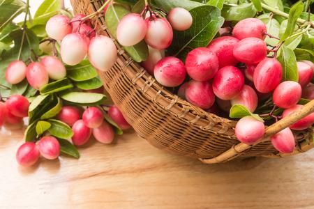 Carunda or Karonda fruits in the basket on wood background  ,Thai fruits