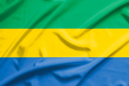 gabon: Gabon flag on soft and smooth silk texture