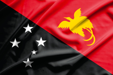 papua: papua new guinea flag on soft and smooth silk texture